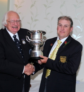 Andy Cliffe receives the Moc Morgan trophy from International President Peter Godfrey